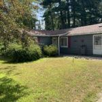 Front yard of house for sale near Mullet Lake